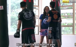 nerdy-nerd-girl-kicks-gym-trainers-ass-beats-prank-malaysian-muay-thai-champion_2